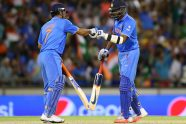 Dhoni, bowlers steer India to quarterfinals - Cricket News