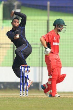 Fiji U19's Peni Vuniwaqa (L) in action.