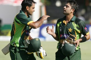 Pakistan's captain Muhammad Hafeez (L) congratulates teammate Ahmed Shehzad (R) for his unbeaten innings of 98 runs. - ICC T20 News