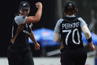 Suzie Bates, the New Zealand captain, celebrates with team mate Morna Nielsen, who picked two wickets. - ICC T20 News