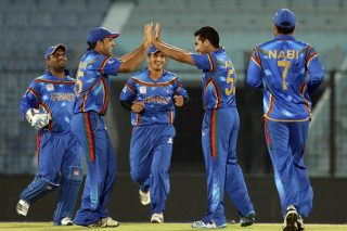 Afghanistan players celebrate after taking a wicket.