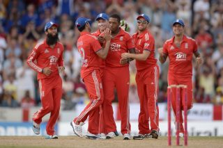 Chris Jordan of England celebrates with teammates after dismissing Johnson Charles. - ICC T20 News