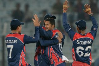 Basant Regmi returned figures of 3 for 14 as Nepal register first win against Hong Kong. - ICC T20 News