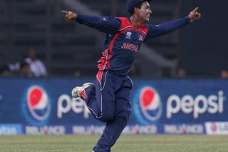 Sompal Kami celebrates taking a catch to dismiss Mohammad Shahzad of Afghanistan. - ICC T20 News