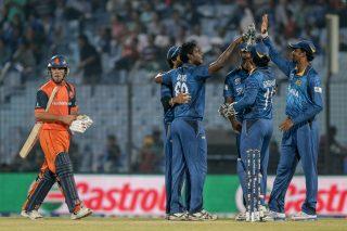 Peter Borren walks back after being dismissed by Angelo Mathews of Sri Lanka. - ICC T20 News