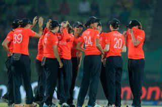 Becky Grundy of England celebrates the wicket of Latika Kumari of India. - ICC T20 News