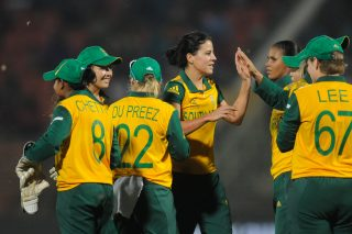 Marizanne Kapp of South Africa celebrates the wicket of Sophie Devine of New Zealand. - ICC T20 News