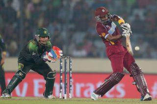 Dwayne Bravo hits a six as Kamran Akmal looks on. - ICC T20 News