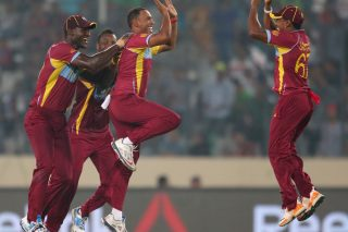 Samuel Badree of the West Indies is congratulated by his teammates after dismissing Shoaib Malik. - ICC T20 News