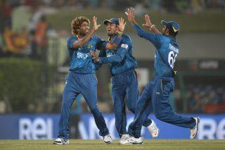 Lasith Malinga of Sri Lanka celebrates with teammates after dismissing Chris Gayle. - ICC T20 News