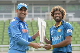 Sri Lanka captain Lasith Malinga and India captain Mahendra Singh Dhoni pose with the ICC World Twenty20 trophy ahead of the final. - ICC T20 News