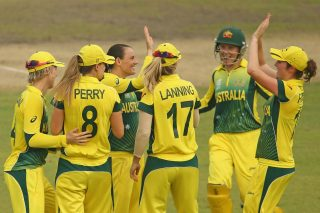 Erin Osborne of Australia is congratulated by her teammates after dismissing Heather Knight of England. - ICC T20 News
