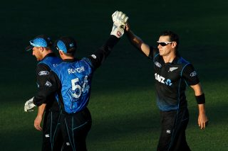 Nathan McCullum celebrates the fall of a wicket with Luke Ronchi.