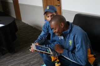 Aaron Phangiso of South Africa uses the twitter mirror during South Africa's open media session.