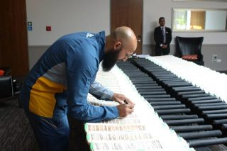 Hashim Amla signs bats during South Africa's open media session.
