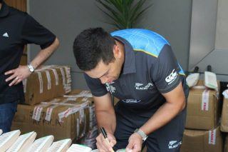 Ross Taylor signs bats during New Zealand's media session.