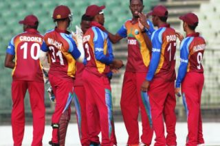 West Indies team celebrate a wicket.