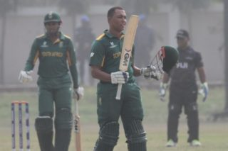 South Africa's  batsman celebrate scoring a century.