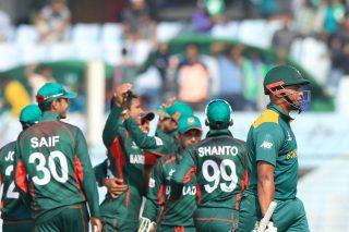 Bangladesh players celebrate a wicket.