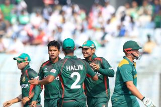 Bangladesh players celebrate the fall of a South Africa wicket.