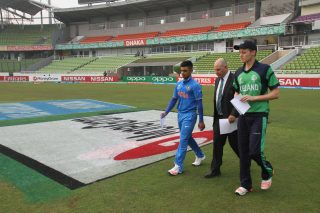 India and Ireland captains walk out for the toss.