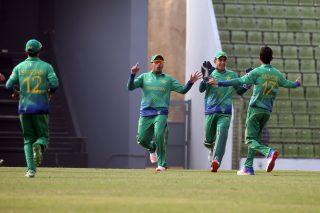 Hasan Mohsin celebrates a wicket.