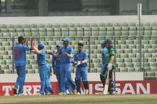 Indian players celebrate a wicket.