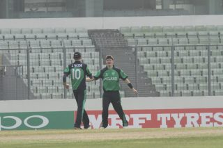Jack Tector celebrates a wicket.