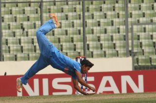 Mohipal takes a fall trying to stop a run.