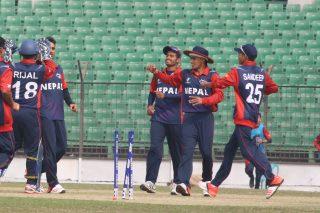 Nepal players celebrate a wicket.