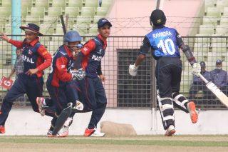 Nepal players celebrate the wicket of Ravindra
