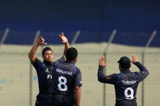 Fiji U19's Tadulala Veitacini celebrating a wicket with teammates.