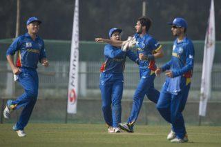 Warren Van Wyk of Namibia celebrates a wicket with his teammates.