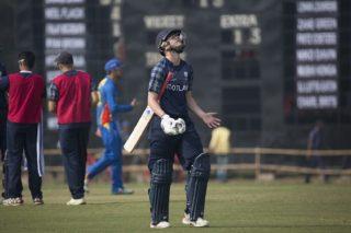 Scotland U19 batsman Rory Johnston walks off the field after his dismissal.