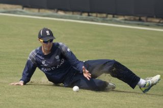 A Scotland U19 player saves a boundary during the match against Namibia U19.