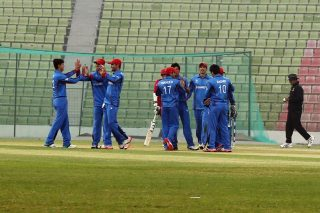 Afghanistan players celebrate the fall of a wicket.