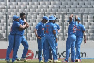 India U-19 celebrates the fall of a Nepal wicket.