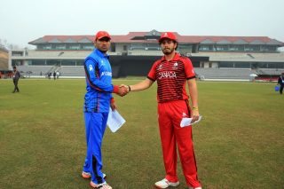 Canada U-19 Captain and Afghanistan U-19 Captain shake hands.