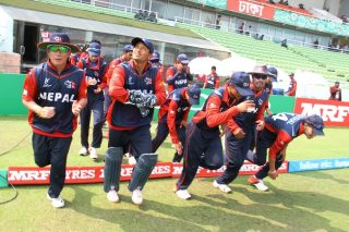 Nepal U-19 enters the field.