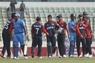 Nepal U-19 players and India U-19 players shake hands after the match.