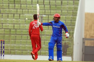 Tariq Stanikzai of Afghanistan U-19 celebrates his 50.