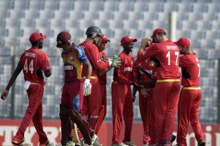 Zimbabwe U-19 players celebrating the fall of a West Indies U-19 player.