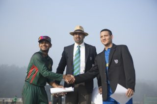 Bangladesh U-19 captain and Namibia U-19 captain shake hands during the toss.