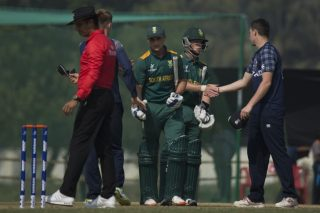 Scotland U-19 players shake hands after the match with South Africa U-19 players.