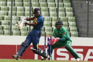 Kamindu  Mendis of Sri Lanka U-19 plays a shot against Pakistan.