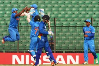 Sarfaraz Khan celebrates the wicket of Zane Green.