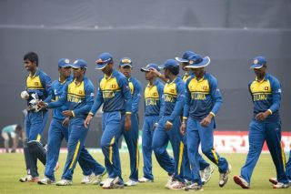 Sri Lanka U-19 players walk back after the India innings.