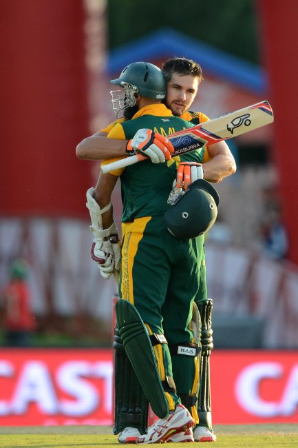 Hashim Amla congratulates Rillee Rossouw after he reached his century.