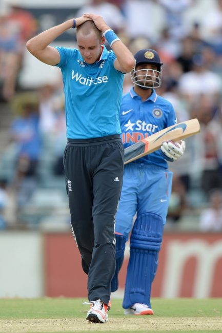 Stuart Broad reacts after being hit for a six by Rahane.