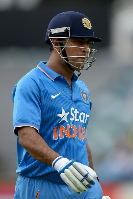 MS Dhoni of India walks off the field after being dismissed.